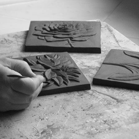 Each master clay relief takes at least 2 days to hand carve.