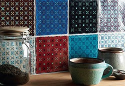 Tapestry effect with Ormeaux Blue on Mint, Chestnut, Red on Mint, Bastille, Blackberry, Amun, Sloe, Glen, Thebes, Rioja, Lagoon and Palomino (Photo: Winchester Tile Co)